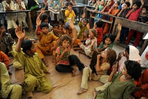 Pakistan Flooding Update: Internally displaced Pakistani children wait for food packages