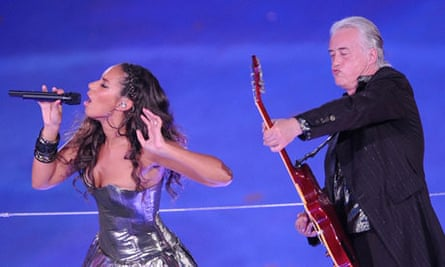 Jimmy Page plays during the Beijing Olympics closing ceremony