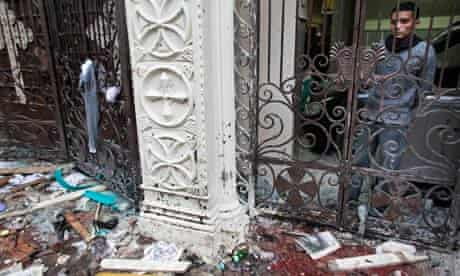 A man observes the scene of the bomb blast from within the Coptic church in Alexandria, Egypt