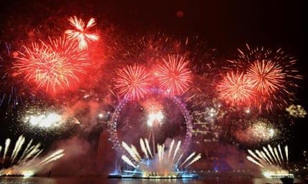Fireworks light up the sky over the London Eye during New Year's Eve celebrations