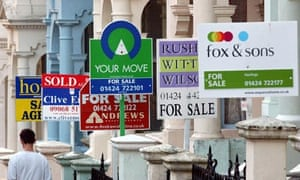 Estate agents' signs on a street