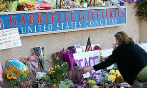 Tributes to congresswoman Gabrielle Giffords outside her district office in Tucson, Arizona