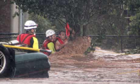 A man is rescued from a tree during a flash flood in Toowoomba, Australia
