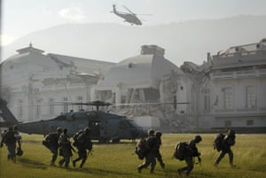 Haiti one year on: January 19: A US Navy helicopter takes off in front of the National Palace