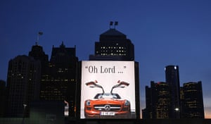 Detroit Auto Show: A Mercedes Benz SLS AMG billboard is shown on a building in Detroit