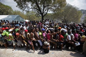 Haiti one year on: March 13: Women stand in line during a food distribution