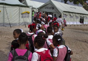 Haiti one year on: April 6: Pupils arrive for class at the Sacred Heart of Turgeau school