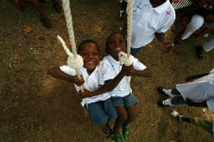 Haiti one year on: December 23: Haitian children await transport with adoptive parents