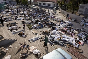 Haiti one year on: January 14: Thousands of bodies lay in front of the morgue