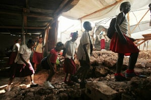 Haiti one year on: January 10, 2011: Pupils walk out of their makeshift classroom