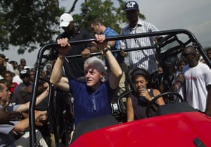Haiti one year on: October 6: Bill Clinton arrives at the Petionville Golf Club