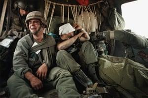 Gulf War: Ken Kozakiewicz (left) breaks down in an evacuation helicopter