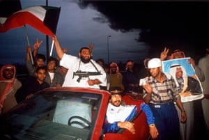 Gulf War: Kuwaitis wave flags in celebration of the liberation of Kuwait