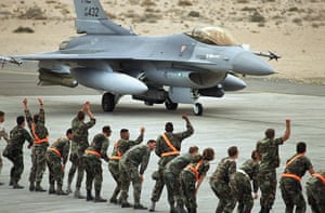 Gulf War: February 18, 1991: A US F-16 fighter plane taxis past cheering ground crew
