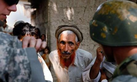 U.S. Army's Dagger Company talk to a village elder