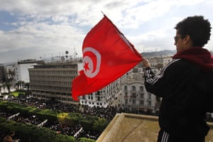 protests in tunisia: A protester waves the Tunisian flag