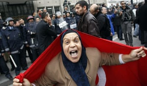 protests in tunisia: A protester with a Tunisian flag