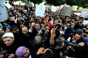 protests in tunisia: Tunisian demostrators shout slogans