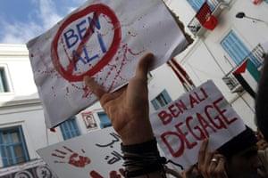 protests in tunisia: placards against ben ali in tunis