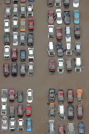 Brisbane Cleanup: Cars sit in receding floodwaters