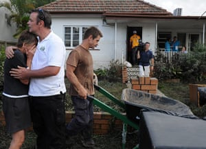 Brisbane Cleanup: Neighbours help with the clean up of the flood damage