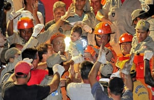 brazil mudslide aftermath: 6-month old baby Nicolas Guimaraes Baretto rescued in brazil