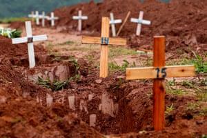brazil mudslide aftermath: graves of victims