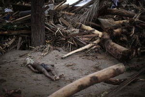 brazil mudslide aftermath: A landslide victim lies next to debris in Teresopolis