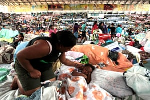 brazil mudslide aftermath: Displaced people seek shelter in a sports hall in Teresopolis