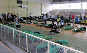 brazil mudslide aftermath: bodies of victims at a gym in Nova Friburgo