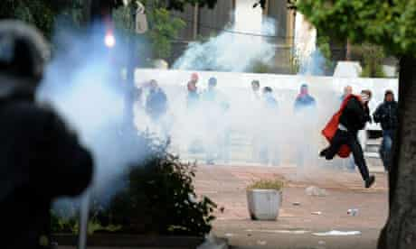 Police and protesters in Tunis exchange volleys of rocks and teargas