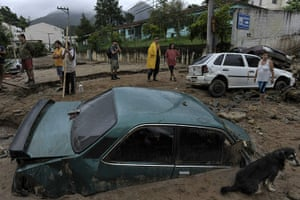 Brazil aftermath: Residents talk in a destroyed street in downtown Nova Friburgo