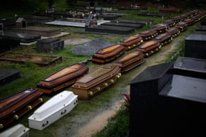 Brazil aftermath: Coffins sit on the floor at a cemetery in Nova Friburgo