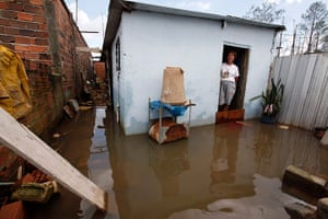 Brazil aftermath: A villager looks on at the entrance of her house in Sao Paulo