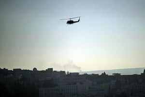 Tunisia: A military helicopter hovers over Tunis