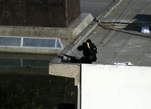 protests in tunisia: A Tunisian police sniper looks through b