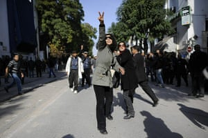 protests in tunisia: A Tunisian demonstrator makes the V-sign