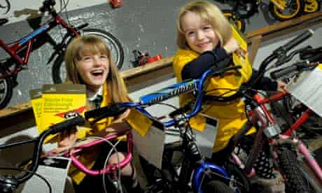 Local school pupils Libby Watson, nine, and Rhiannon Cochren, five, at The Bike Station to collect their prize bikes | pic: Changeworks