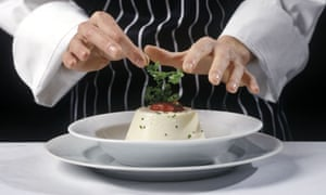 A chef putting the final touches to a dish