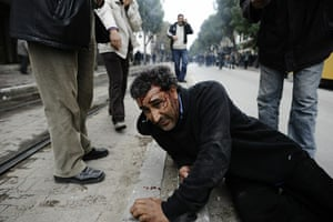 Tunis protest: A man lies injuried during a demonstration in Tunis