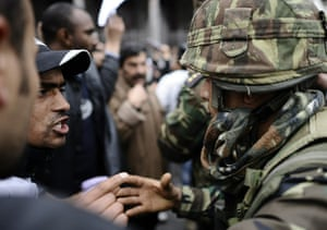 Tunis protest: A demonstrator gestures as he speaks to a soldier, Tunis