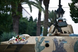 Tunis protest: Flowers are displayed on a Tunisian army tank