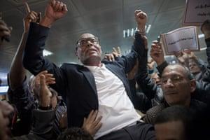 Tunis protest: Tunisian opposition figure Moncef Markouzi celebrates