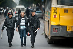 Tunis protest: A protester is arrested by policemen in Tunis