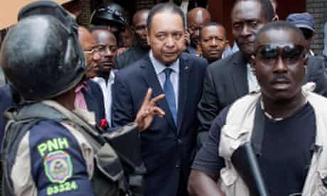 Haiti's ex-dictator Jean-Claude 'Baby Doc' Duvalier is taken out of his hotel