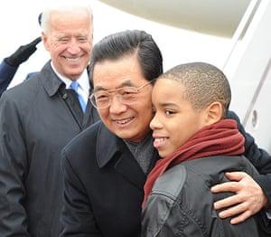 Hu Jintao in Washington: Chinese President Hu Jintao hugs a boy greeting him at Washington