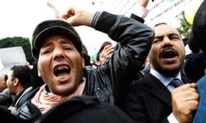 Protesters shout during the civilian unrest in Tunisia