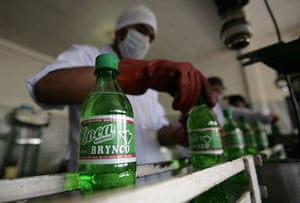 Coca products: A worker screws on the cap on a bottle of Coca Brynco by Soda Pacena