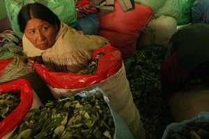 Coca products: A Bolivian coca leaf producer waits for customers