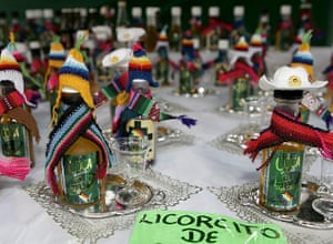 Coca products: Alcoholic products made of coca plants on display at a coca growers' fair
